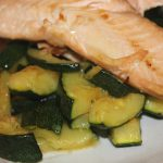 Salmon on a bed of garlic courgettes